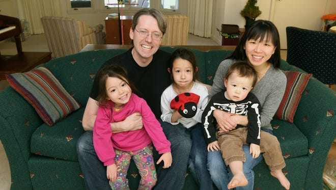 Clyde Hull and his wife Caisy Hung with their children Branwen, 4, Arwen,7, and Corwin, 1, will celebrate the Chinese new year.