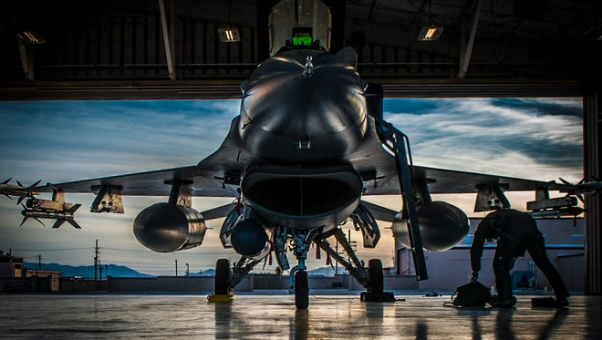 An F-16 Fighting Falcon sits in a hangar prior to departure at Holloman Air Force Base, N.M. May 13, 2015. F-16 students from the 311th Fighter Squadron, a tenant until from Luke Air Force Base, Ariz., are currently flying night operations as part of their syllabus. During the night operations, the students are becoming familiarized with night vision goggles while performing combat training missions.