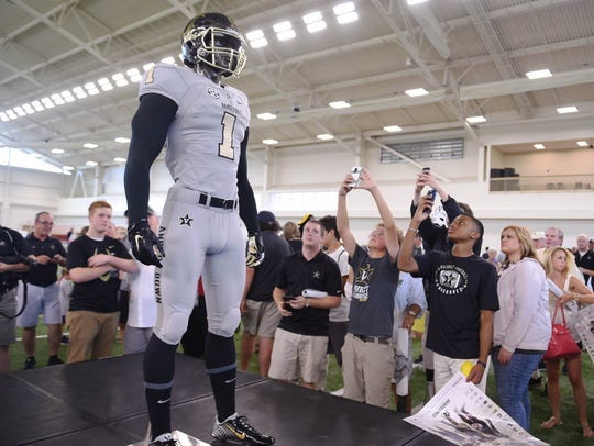 The Vanderbilt football team unveiled a new Nike alternate uniform and helmet during its annual Dore Jam fan event in 2015.