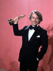 """In this March 28, 1977, file photo, John C. Avildsen shows off the Oscar he won for best director for """"Rocky"""" at the Academy Awards in Los Angeles."""