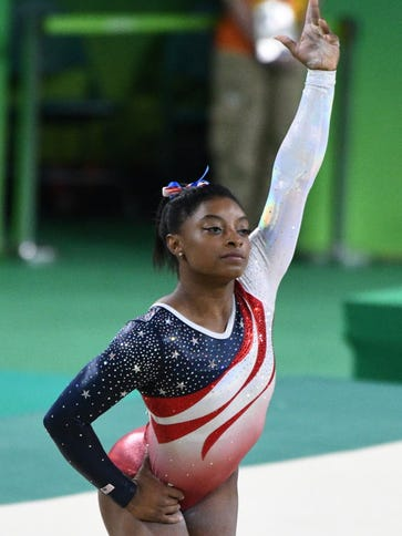 Simone Biles will carry the USA flag at the closing