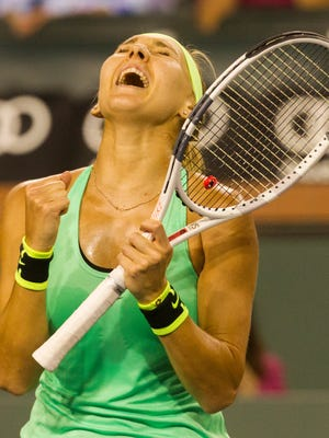 Elena Vesnina of Russia celebrates her quarter final win over Venus Williams of the United States of America on Stadium 1 during the 2017 BNP Paribas Open at Indian Wells Tennis Garden on March 16, 2017.