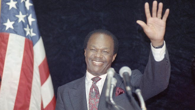 District of Columbia Mayor Marion Barry waves to supporters after addressing city employees in Washington in this Tuesday, March 14, 1990 file photo.