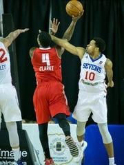 Delaware 87ers forward, Rodney Carney, tries to block a shot against the Maine Red Claws during a recent game at the Bob Carpenter Center.