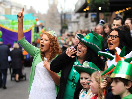 Spectators gather for the St Patrick's Day parade in Trafalgar Square, in central London  March 18, 2012.    REUTERS/Olivia Harris