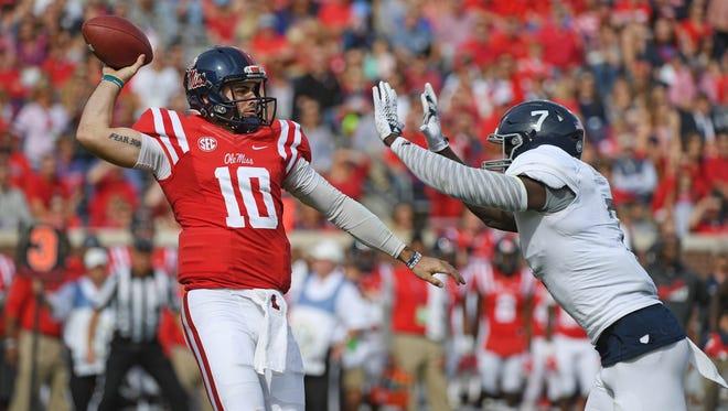 Georgia Southern linebacker Ukeme Eligwe pressures Ole Miss quarterback Chad Kelly during the first quarter.