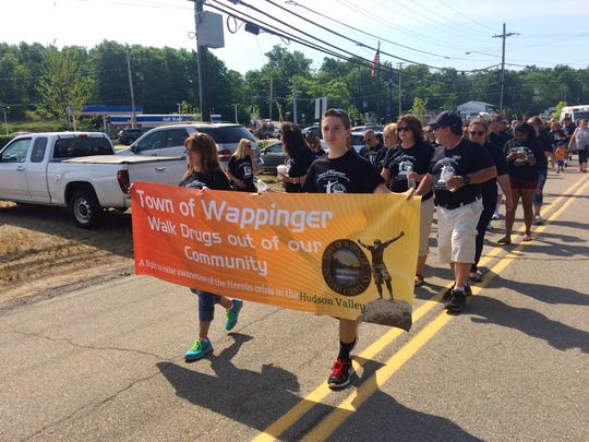 Approximately 100 people participated in a walk to raise awareness about drug abuse in the Town of Wappinger Sunday.