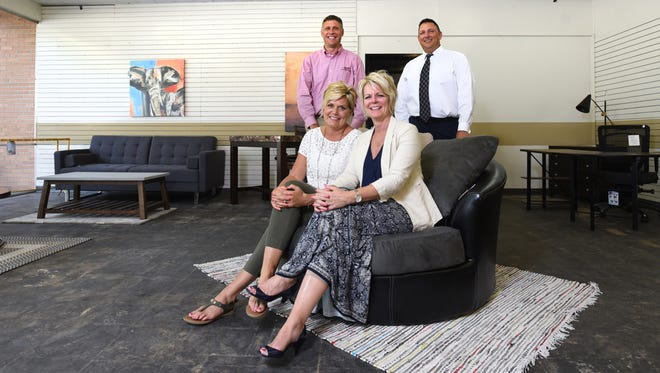 Brian and Christy Fargus, right, partnered with Doug and Lynda Miller to open 4 La Casa, a designer furniture outlet on Linden Avenue in Zanesville.