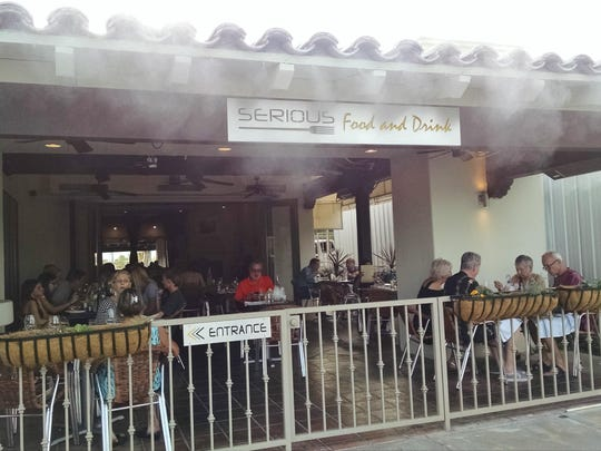 Misters cool patrons who choose to dine on the patio facing Palm Canyon Drive.