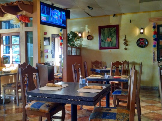 The interior of Los Pepes includes this bright and cozy dining room.