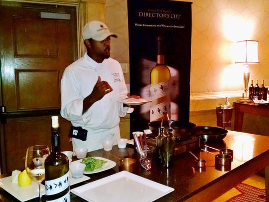 Executive Sous Chef Antwon Brinson performs a course demonstration.