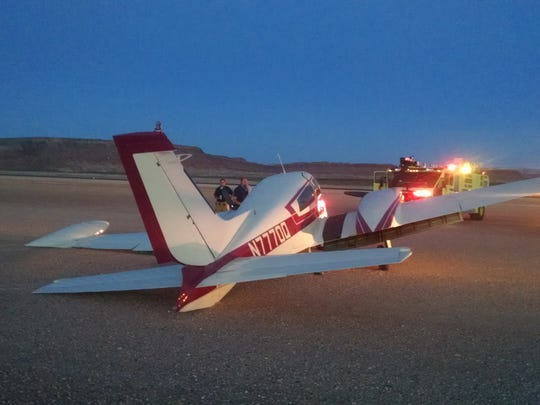 A Cesna 310 leans to the left after its landing gear collapsed, causing it to slide off the runway, damaging the wing and engine at the St. George Municipal Airport Friday.