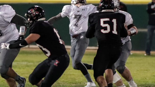 Rancho Mirage quarterback David Talley loses control of the ball for a moment during play against Katella at the CIF Southern Section Division 11 semifinals played in Anaheim, CA on Friday, November 24, 2017.
