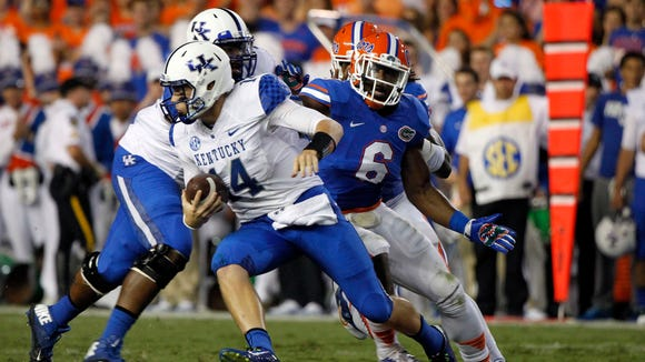 Sep 13, 2014; Gainesville, FL, USA; Florida Gators defensive lineman Dante Fowler Jr. (6) rushes Kentucky Wildcats quarterback Patrick Towles (14)  during the second quarter at Ben Hill Griffin Stadium. Mandatory Credit: Kim Klement-USA TODAY Sports