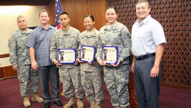 Warrant Officers Brian Enderes, Sarah Uchida and Sgt. Melissa Meno were recognized by Gov. Eddie Calvo on Tuesday, Sept. 29.