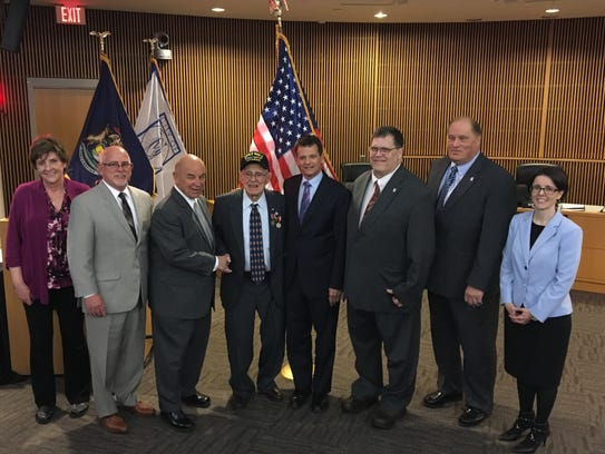 Members of the Novi City Council pose for a photo with