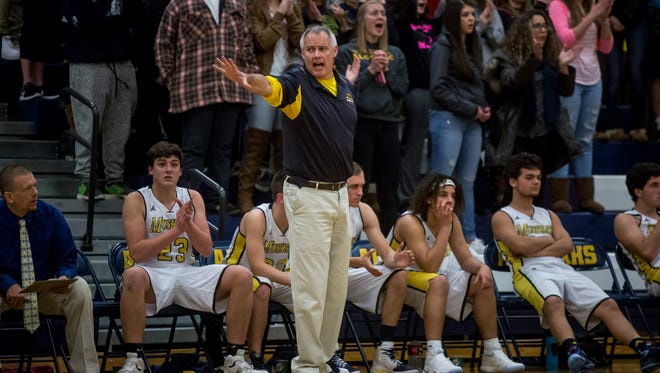 Algonac coach John Highstreet yells out to players during a basketball game Thursday, Dec. 8, 2016 at Algonac High School.