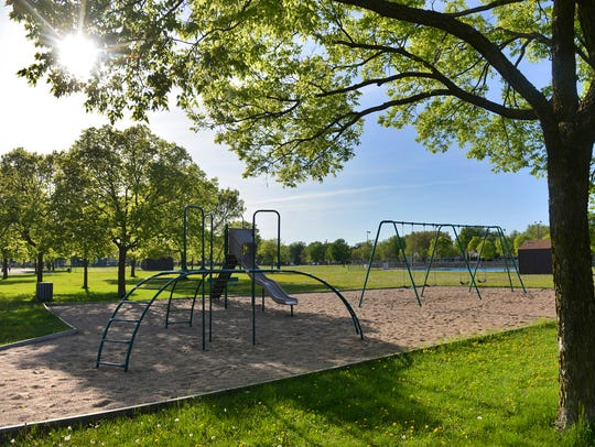 Centennial Park has two sets of playground equipment,