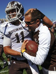 Western Michigan head coach P.J. Fleck, right, gets the game ball from Western Michigan quarterback Zach Terrell (11) after beating Northwestern 22-21 on Sept. 3, 2016.