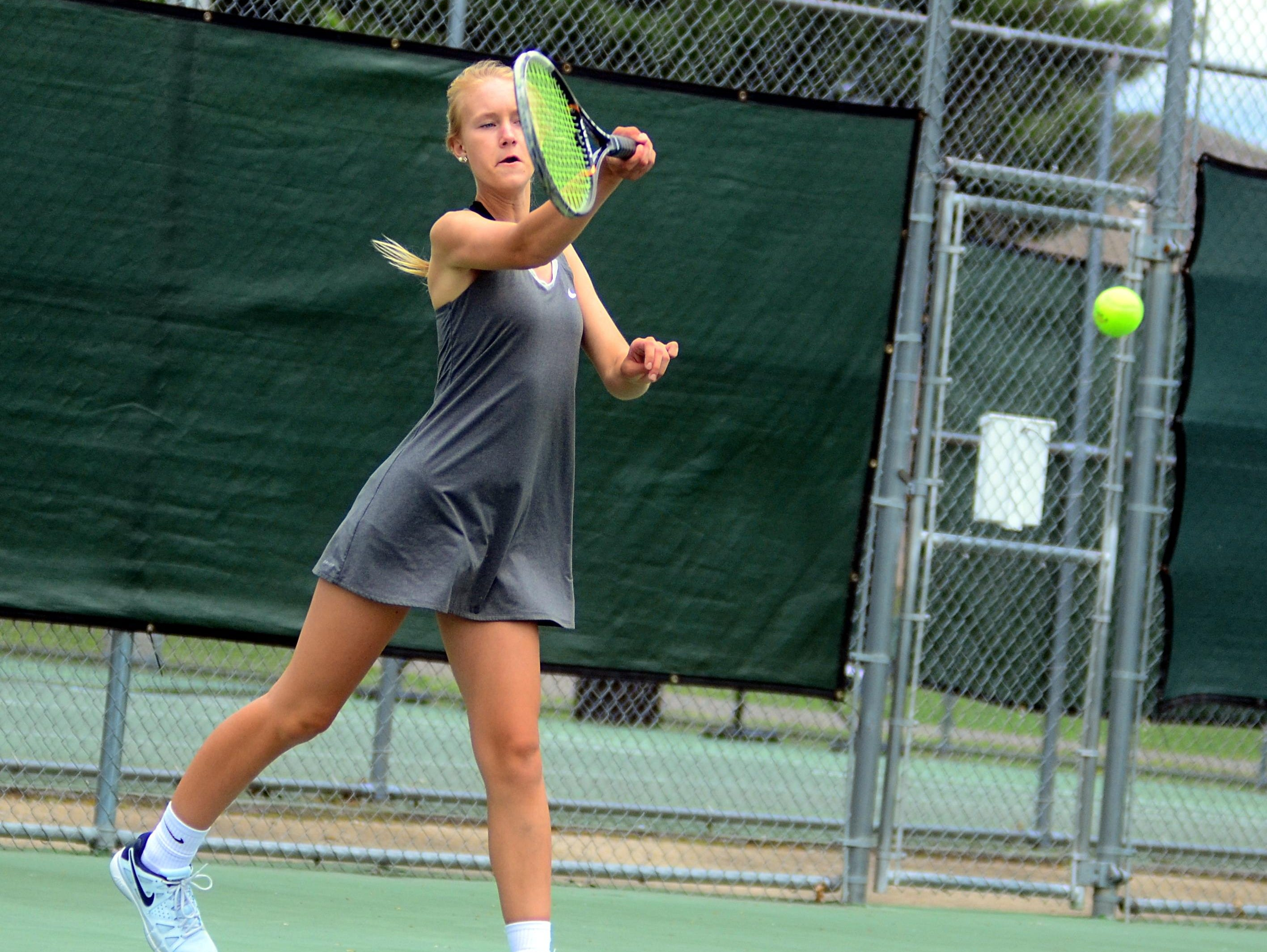 Hendersonville High sophomore Kayla Conger hits a forehand during Tuesday's District 9-AAA Individual Tennis Tournament. Conger advanced to the semifinals before suffering a straight-set loss to Mt. Juliet's Kayla Conger.