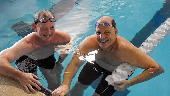 Roberson swimming coach Jim Cottam, right.