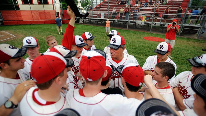 FILE - Center Grove head coach Dave Gandolph congratulates his team, May 21, 2011. Center Grove named Keith Hartfield as Gandolph's successor this week.