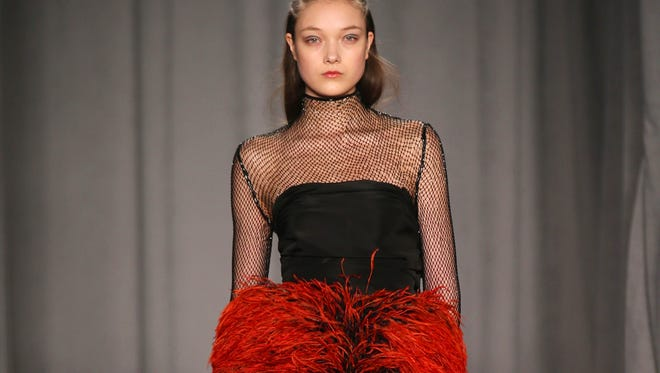 Feathers, anyone? A model walks the runway at Marchesa.