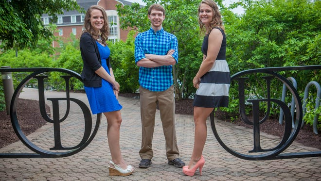 Triplets Leslie (right), James and Stephanie Manning at the University of Delaware.