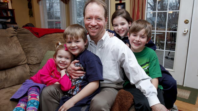 Kidney transplant patient Robert Waddell is shown in 2010 with his children, from left, Bailey, Christian, Casey and Robby. Waddell received bone marrow stem cells from the friend who donated the kidney in 2009. Waddell, a Catholic, would have opposed the use of embryonic stem cells. Recent gains in the use of adult stem cells have made the debate over use of embryonic stem cells almost moot, some say.