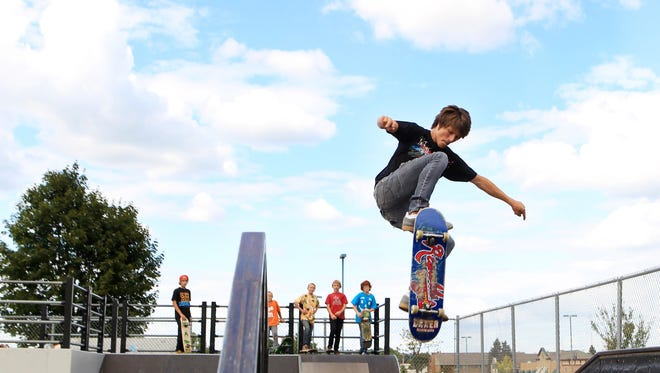 Steven Gromley, 17, of Marshfield uses the launch at the Marshfield Skate Park to work on an ollie on Monday, August 20, 2012.