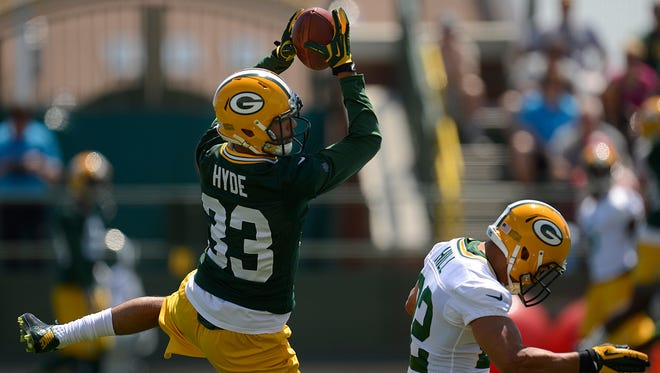 Green Bay Packers cornerback Micah Hyde (33) catches the ball over running back Michael Hill (22) while running drills during OTAs at Ray Nitschke Field on Thursday, May 29, 2014. Evan Siegle/Press-Gazette Media
