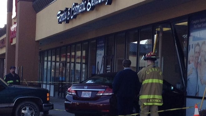 A car crashed into a lobby where people waited inside the lobby at Buttermilk Family & Cosmetic Dentistry in Crescent Springs shortly around 10 a.m. today after jumping the sidewalk curb and crashing through a row of glass windows.