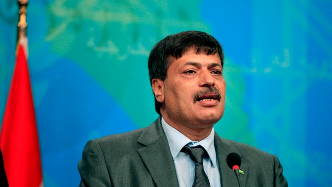 Ziad Abu Ain speaks to reporters during a news conference in Baghdad on  Dec. 10, 2012.