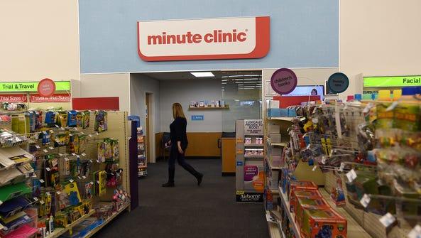A shopper walks past a Minute Clinic at a CVS Pharmacy