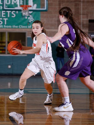 Charlotte's Carly Scheblo, left, drives against Fowlerville's Jackie Jarvis, Tuesday, March 6, 2018, in Williamston, Mich. Fowlerville won 52-40.