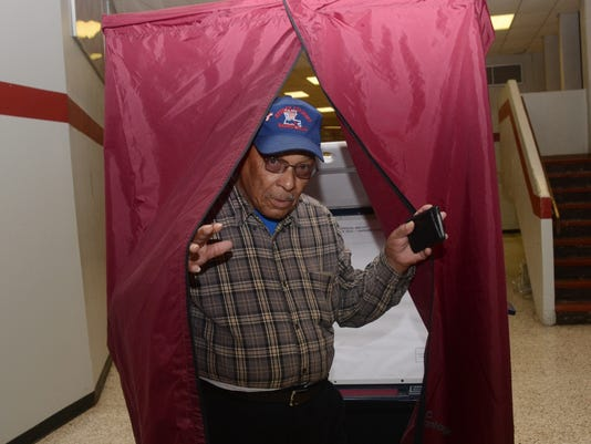ANI Voting Joseph Hertzog emerges from the voting booth after casting his vote at Precinct 5 at Pineville High School Saturday, Dec. 6, 2014. Polling commissioners said there was a line when the polls opened.--Melinda Martinez/mmartinez@thetowntalk.com