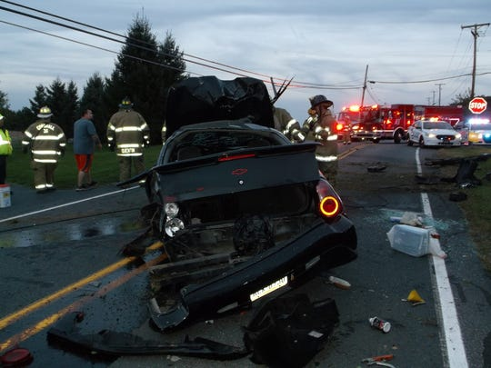 Firefighters stand by the wreckage of a car driven by 58-year-old Stanley Robinson of Lebanon, who lost control while traveling at a high rate of speed on Route 72 Tuesday evening.