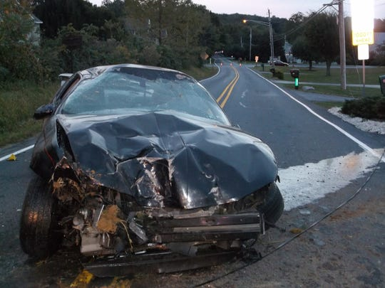 The wreckage of a car driven by 58-year-old Stanley Robinson of Lebanon rests on Zinns Mill Road after he lost control of it while traveling at a high rate of speed on Route 72 Tuesday evening, police said.