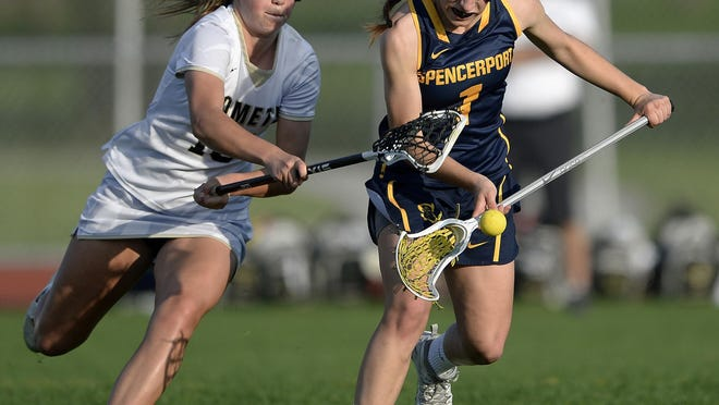 Spencerport's Olivia Wall, right, scoops up the ball in front of Rush-Henrietta's Maddy George during a regular season game at Rush-Henrietta High School on Wednesday, May 9, 2018. Rush-Henrietta beat Spencerport 18-9.