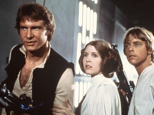 "Harrison Ford as Han Solo, Carrie Fisher as Princess Leia Organa and Mark Hamill as Luke Skywalker in a scene from ""Star Wars: Episode IV - A New Hope."""