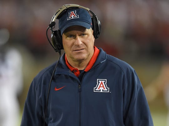 Arizona football coach Rich Rodriguez looks on from