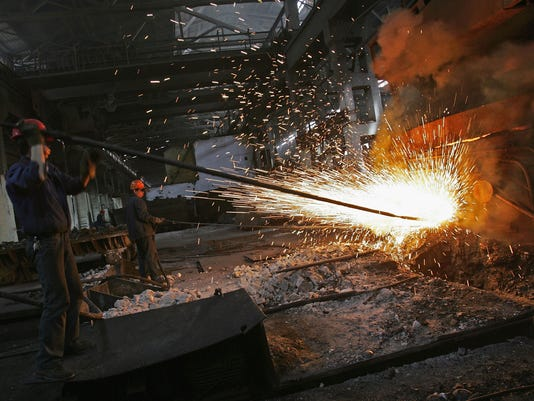 GTY WORKERS MANUFACTURE STEEL IN XINING I FIN CHN QI