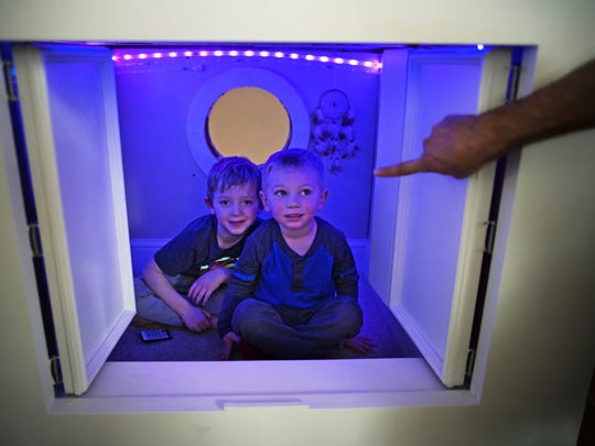 Elliot and Leo hide in their secret retreat tucked under the home's foyer staircase. (Richard Tsong-Taatarii/Minneapolis Star Tribune/TNS)