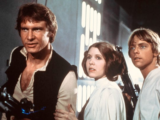 Harrison Ford, Carrie Fisher, and Mark Hamill are shown