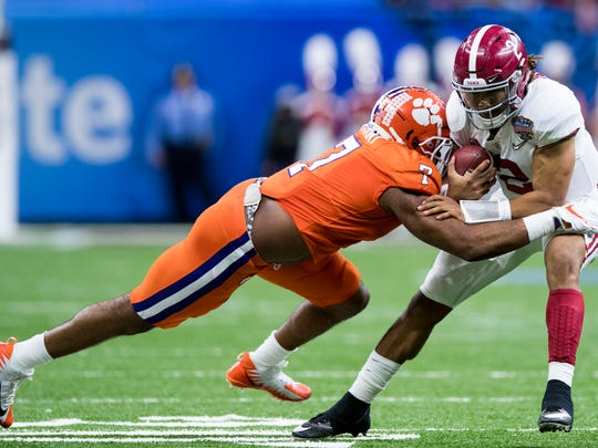 Clemson defensive end Austin Bryant (7) stops Alabama quarterback Jalen Hurts (2) in first half action in the Sugar Bowl at the Superdome in New Orleans, La. on Monday January 1, 2018. (Mickey Welsh / Montgomery Advertiser)