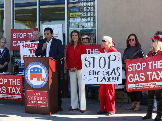 Nachhatter Chandi speaks to a small crowd of opponents of the gas tax at the Arco AM PM gas station on Jefferson St., January 21, 2018.