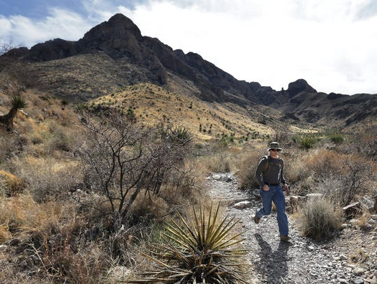 A man runs down the Ron Coleman Trail in the Franklin Mountains.