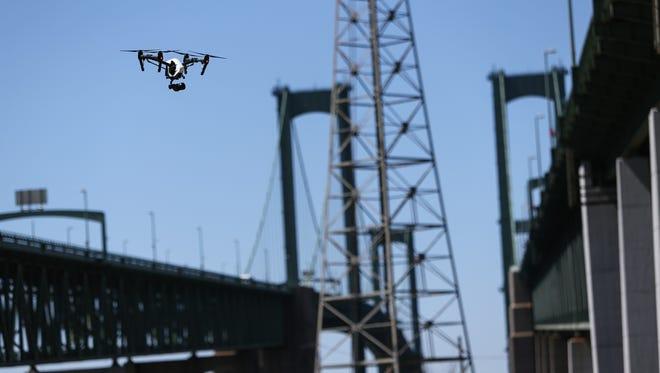 Keystone Aerial Surveys flies a DJI Inspire quadcopter to take photos and video of the Delaware Memorial Bridge Tuesday.