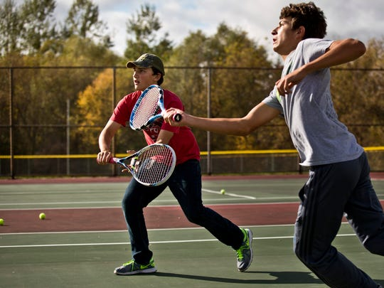 Freshman Anthony Offner and sophomore Mason Smith play doubles during tennis practice Tuesday, October 13, 2015 at Armada High School.
