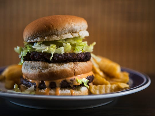 October 26, 2016 - The Big Smack at Imagine Vegan Cafe includes two non-beef patties, special sauce, lettuce, cheese, pickles, and an onion on a dairy-free bun. The restaurant is moving from its former location at 2299 Young Ave. to 2158 Young Ave. and will be re-opening in mid-November.